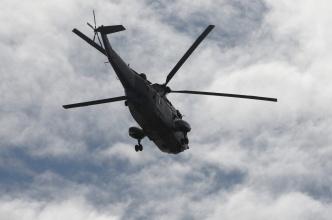 Helikoptéra (během připlouvání k Atlantis ve člunu)